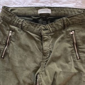 Army green skinnies with zippers